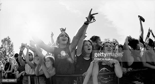 Festival crowd against a barrier at Mudsling Murdoch University W. Australia 1990s.