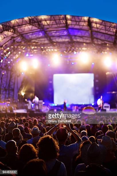 festival crowd in front of stage - popular music concert stock pictures, royalty-free photos & images