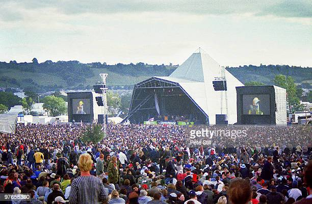 A festival crowd watch Ocean Colour Scene perform on the Pyramid Stage at the Glastonbury Festival on June 24th 2000 in Glastonbury England