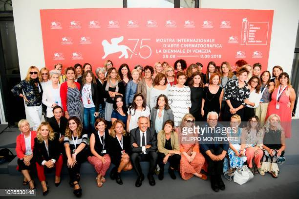 Festival Director Alberto Barbera and President of the Venice Biennale Paolo Baratta attend a photocall with women working in the film television and...