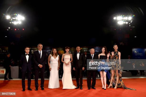 Festival director Alberto Barbera Angeles Woo Ha JiWon Zhang Hanyu John Woo Qi Wei Tao Okamoto and guest walk the red carpet ahead of the 'Manhunt '...