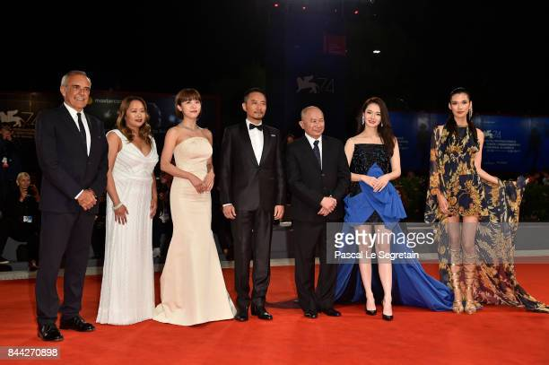 Festival director Alberto Barbera Angeles Woo Ha JiWon Zhang Hanyu John Woo Qi Wei and Tao Okamoto walk the red carpet ahead of the 'Manhunt '...