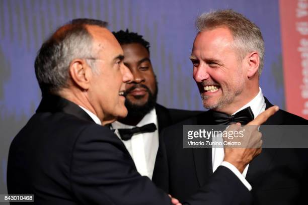 Festival director Alberto Barbera William Kaloubi and François Troukens walk the red carpet ahead of the 'Above The Law ' screening during the 74th...