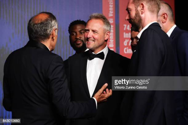 Festival director Alberto BarberaWilliam Kaloubi and François Troukens walks the red carpet ahead of the 'Above The Law ' screening during the 74th...