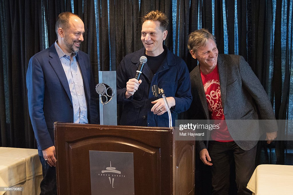 Festival Director Carl Spence presents the Seattle International Film Festival Golden Space Needle Award for best film 'Captain Fantastic' to Director Matt Ross and actor Viggo Mortensen on June 12, 2016 in Seattle, Washington.