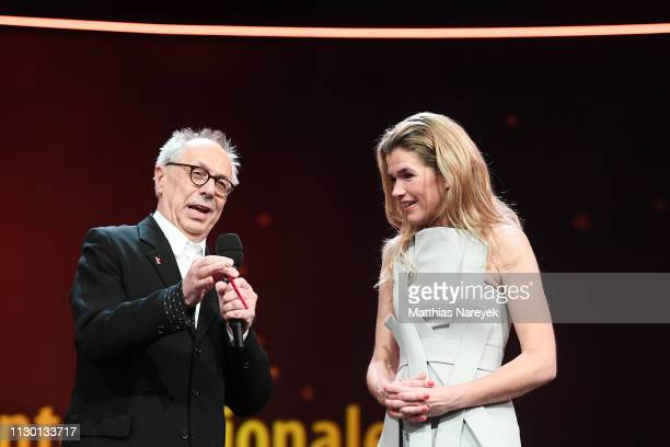 Festival director Dieter Kosslick and Anke Engelke are seen on stage at the closing ceremony of the 69th Berlinale International Film Festival Berlin...
