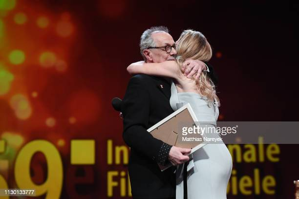 Festival director Dieter Kosslick and Anke Engelke hug each other on stage at the closing ceremony of the 69th Berlinale International Film Festival...