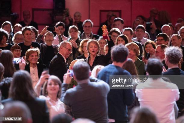 Festival director Dieter Kosslick and Charlotte Rampling are seen in the audience at the Homage Charlotte Rampling Honorary Golden Bear award...