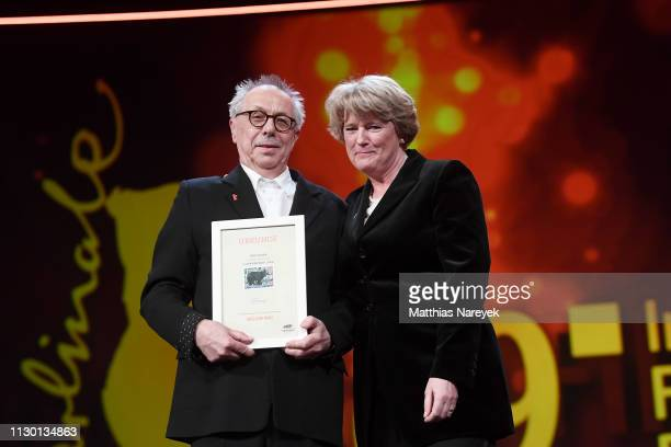 Festival director Dieter Kosslick and Federal Commissioner for Culture and Media Monika Gruetters are seen on stage at the closing ceremony of the...