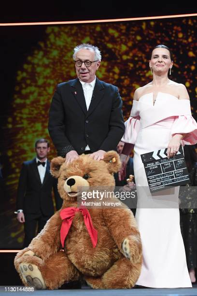 Festival director Dieter Kosslick and President of the International Jury Juliette Binoche are seen on stage at the closing ceremony of the 69th...