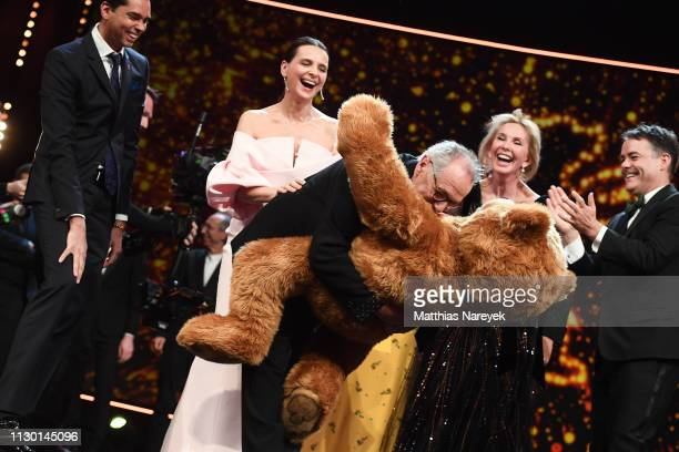 Festival director Dieter Kosslick with a stuffed bear is seen on stage in front of Rajendra Roy Juliette Binoche Trudie Styler and Sebastián Lelio at...