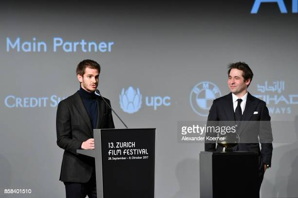 Festival director Karl Spoerri watches as actor Andrew Garfield speaks on stage after receiving the ZFF Golden Eye Award ahead of the 'Breathe'...