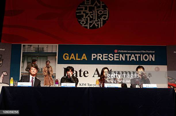 Festival director Lee YongKwan director Kim TaeYong actress Tang Wei and actor Hyun Bin attend during a Gala Presentation of 'Late Autumn' of the...
