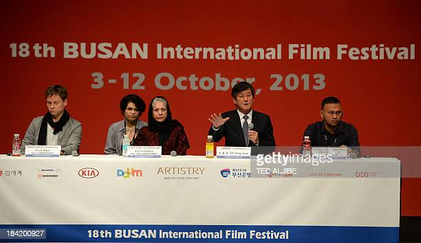 BIFF festival director Lee YongKwan gestures while members of the jury Adolfo Alix Jr of the Philippines Rakhshan Banietemad of Iran and Ryan...