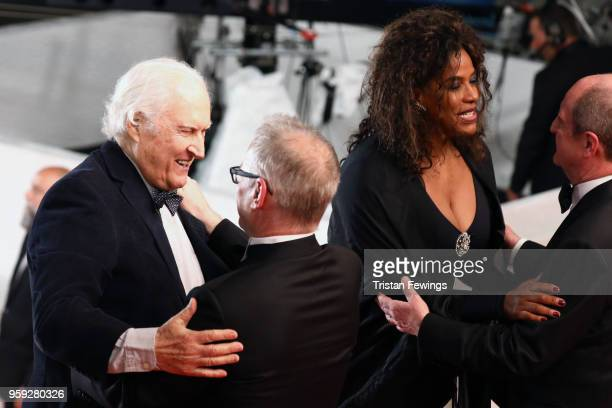 Festival Directors Thierry Fremaux and Pierre Lescure greet director Fernando Solanas and his wife Angela Correa as they attend the screening of...