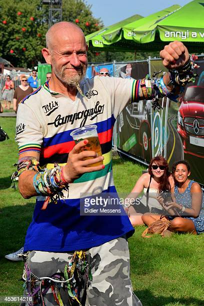 A festival fan wearing more than 200 entrance bracelets visits the Sziget Festival on August 11 2014 in Budapest Hungary
