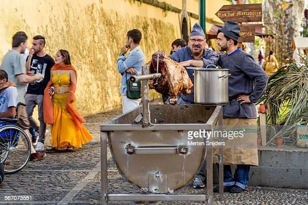 Festival food pig roasting on spit