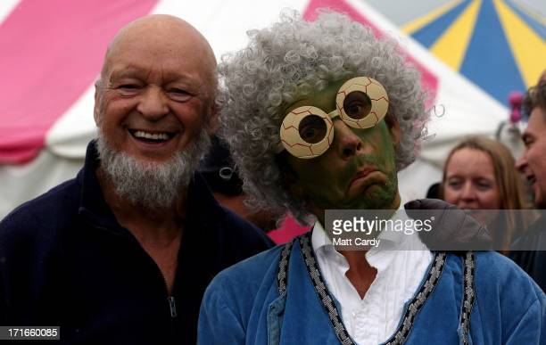 Festival founder Michael Eavis poses for a photograph with a performer at the Glastonbury Festival of Contemporary Performing Arts site at Worthy...