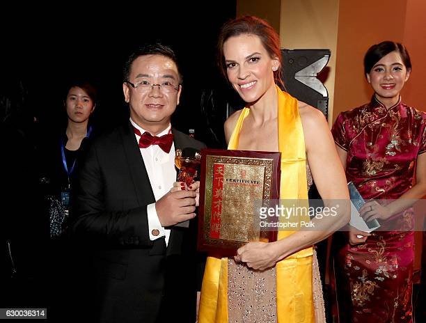 Festival founder Wang Haige and Hilary Swank pose backstage during the 21st Annual Huading Global Film Awards at The Theatre at Ace Hotel on December...