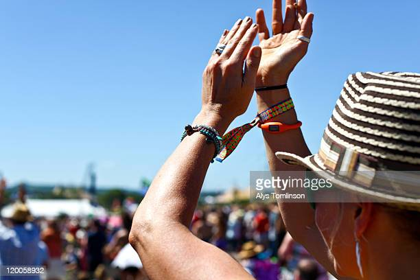 festival goer at glastonbury festival 2011 - clapping hands stock pictures, royalty-free photos & images