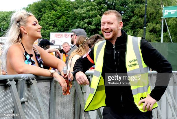 Festival goer attempts to flirt with security staff at Parklife Festival 2017 at Heaton Park on June 11, 2017 in Manchester, England.