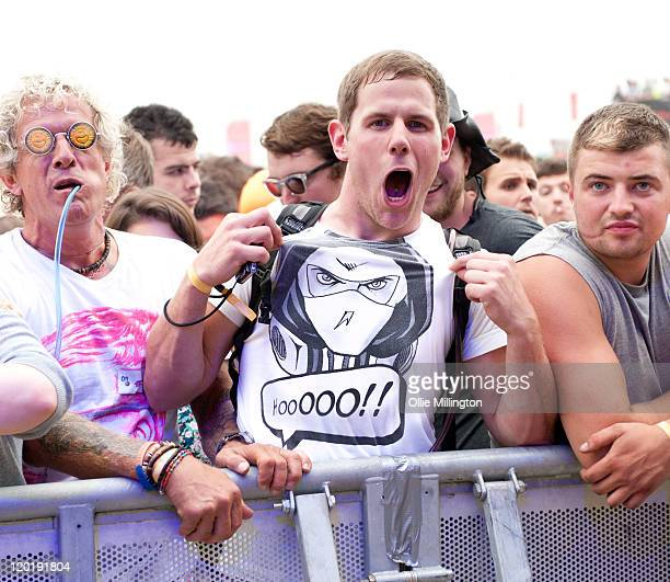 A festival goer attends the Jaguar Skills performance on the main stage during the first day of Global Gathering at Long Marston Airfield on July 29...