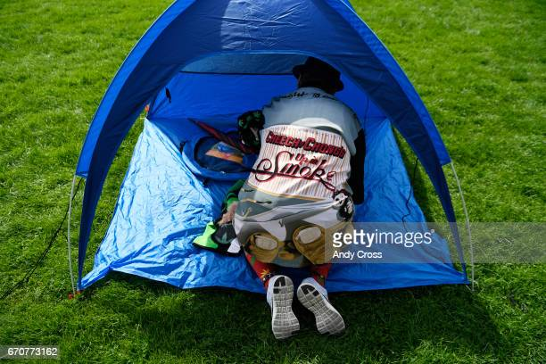 Festival goer Denver native Paulette Cordova sporting a Cheech and Chong shirt sets up her tent at Denver's 420 rally at Civic Center Park April 20...