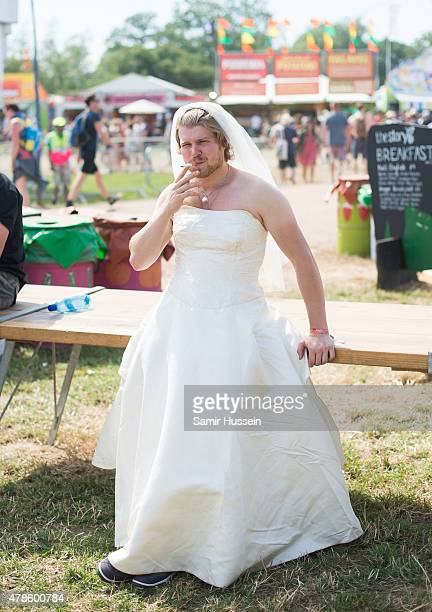 A festival goer dresses as a bride at the Glastonbury Festival at Worthy Farm Pilton on June 25 2015 in Glastonbury England