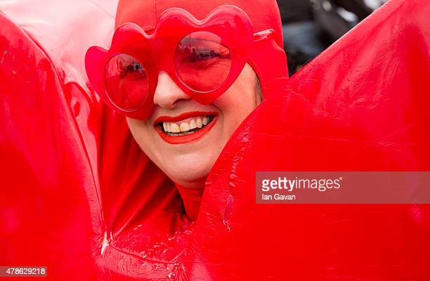 A festival goer enjoy the atmosphere at the Glastonbury Festival at Worthy Farm Pilton on June 26 2015 in Glastonbury England Now its 45th year the...