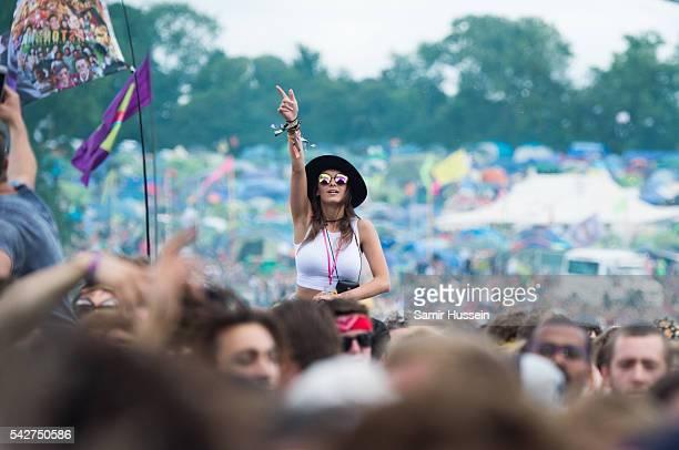 A festival goer enjoys Glastonbury Festival 2016 at Worthy Farm Pilton on June 24 2016 in Glastonbury England