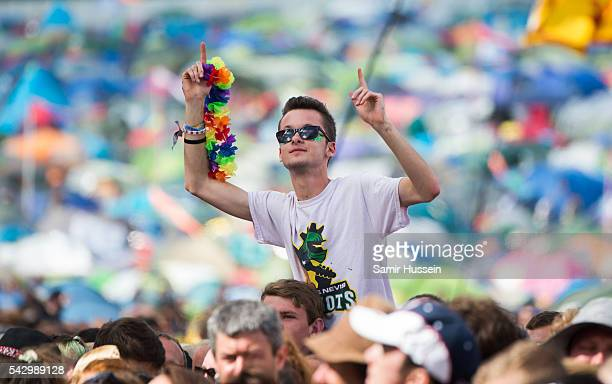 A festival goer enjoys Glastonbury Festival 2016 at Worthy Farm Pilton on June 25 2016 in Glastonbury England