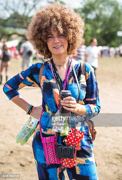 A festival goer enjoys the atmosphere at the Glastonbury Festival at Worthy Farm Pilton on June 27 2015 in Glastonbury England Now its 45th year the...