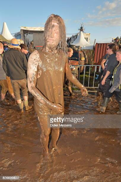 A festival goer enjoys the mud and dirt during the Wacken Open Air festival on August 3 2017 in Wacken Germany Wacken is a village in northern...
