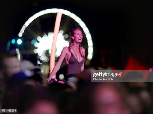 A festival goer enjoys the show as M83 performs on day 1 of the 2016 Coachella Valley Music Arts Festival Weekend 1 at the Empire Polo Club on April...