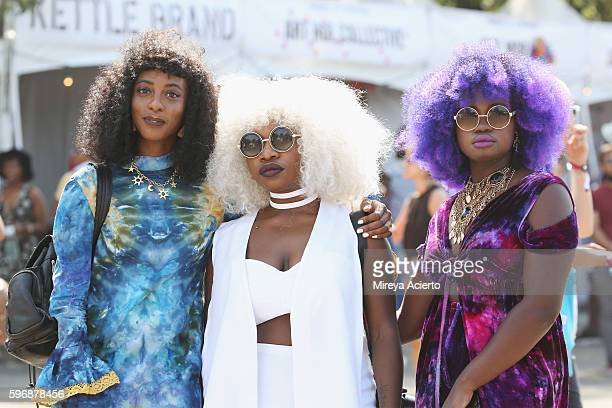 Festival goer Fei Mancho Agnes Ashi and Akua Addo attend the 12th Annual Afropunk Brooklyn Festival at Commodore Barry Park on August 27 2016 in...