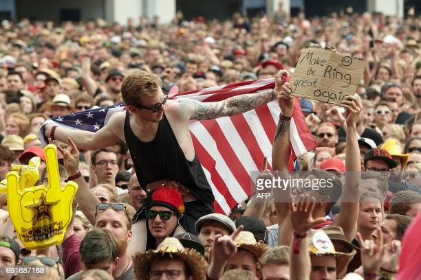 A festival goer holds a banner during a performance of 'Sum 41' group at the 'Rock am Ring' music festival on June 3 2017 in Nuerburg Germany's...