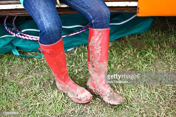 a festival goer in wellies at glastonbury 2011 - wellington boot stock pictures, royalty-free photos & images
