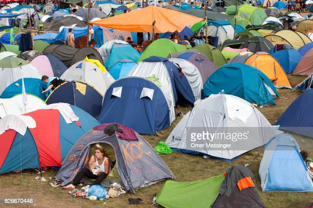 A festival goer is seen eating breakfast in her tent at the 2017 Woodstock Festival Poland on August 4 2017 in Kostrzyn Poland The threeday rock...