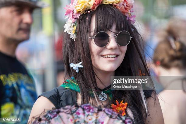 A festival goer is seen wearing glasses and a wreath of flowers at the 2017 Woodstock Festival Poland on August 4 2017 in Kostrzyn Poland The...