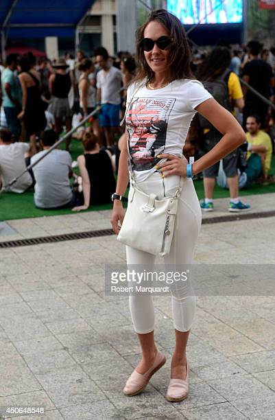 A festival goer poses with a Hermes handbag for a street fashion portrait at Sonar Music Festival 2014 on June 13 2014 in Barcelona Spain