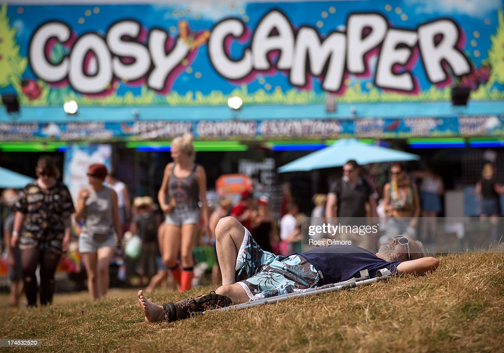 Festival goer sleeps near the main stage at The Wickerman festival on July 27, 2013 in Dundrennan, Scotland.