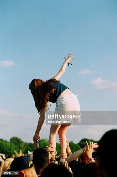 Festival Goer Standing On Shoulders