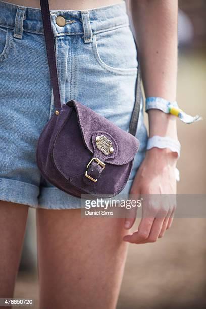 Festival goer wearing a bag at the Glastonbury Festival at Worthy Farm Pilton on June 27 2015 in Glastonbury England