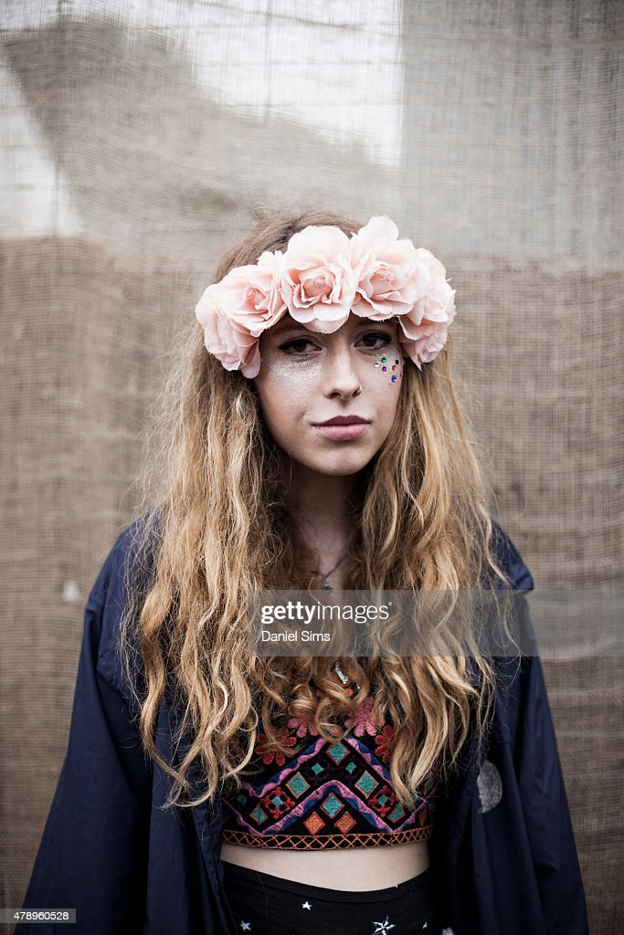 Festival goer wearing a floral head dress at the Glastonbury Festival at Worthy Farm, Pilton on June 28, 2015 in Glastonbury, England.