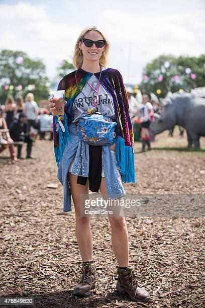 Festival goer wears an ASOS shawl at the Glastonbury Festival at Worthy Farm Pilton on June 27 2015 in Glastonbury England