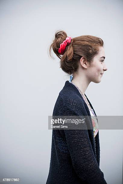 Festival goer with a messy bun hairstyle at the Glastonbury Festival at Worthy Farm Pilton on June 28 2015 in Glastonbury England