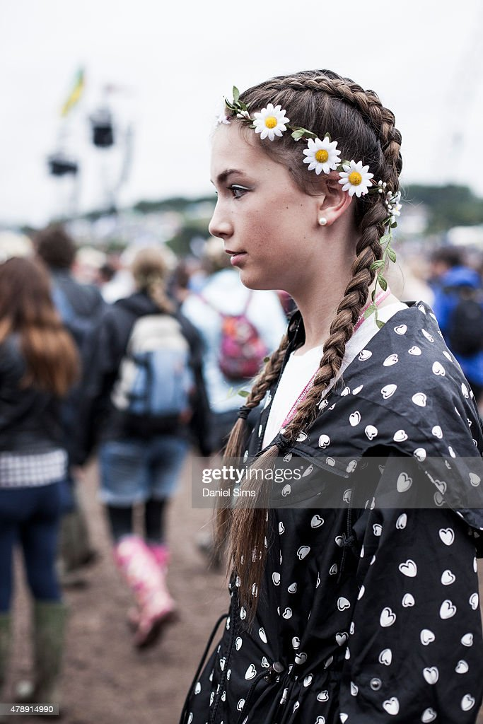 Festival goer with french plaits and a flower head band at the Glastonbury Festival at Worthy Farm, Pilton on June 28, 2015 in Glastonbury, England.