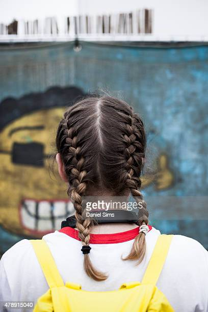 Festival goer with french plaits at the Glastonbury Festival at Worthy Farm Pilton on June 28 2015 in Glastonbury England