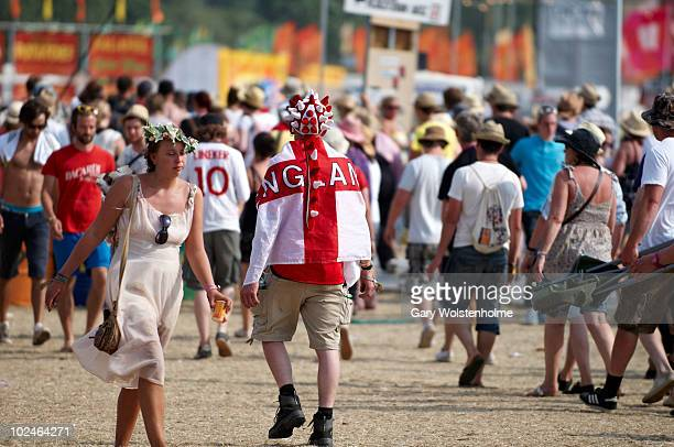Festival goers and an England fan during the fourth day of Glastonbury Festival at Worthy Farm on June 27, 2010 in Glastonbury, England.