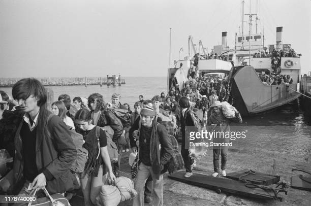 Festival goers and music fans walk off the Lymington to Yarmouth ferry at Yarmouth harbour on the Isle of Wight to attend the Isle of Wight Festival...